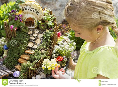 garden in a flower pot child looking at garden in a flower pot outdoors