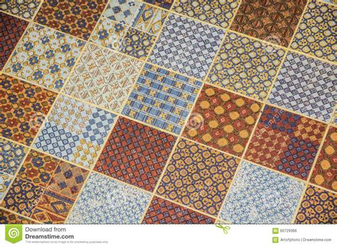 tiled or linoleum floor covering with repeating square