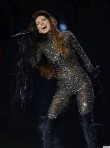 shania 47 stuns in a jeweled catsuit during
