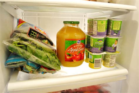 Shelf Of Yogurt by Restocking Our Fridge On The Cheap House