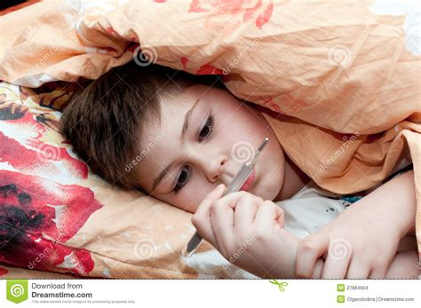 sick in bed images sick boy lying in bed stock images image 27884604