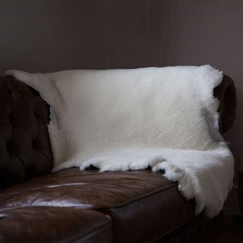 sheepskin throw for sofa 25 best sheepskin throw ideas on pinterest sheepskin