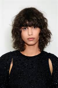 perms for hair with bangs yes curly bangs are back here s how to pull them off