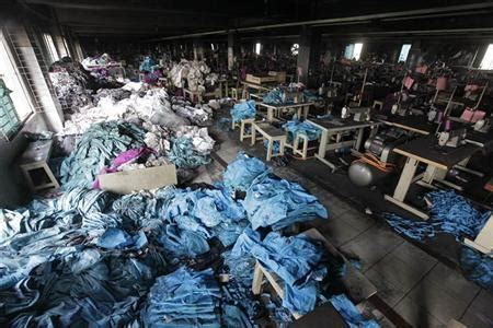 piles of clothes are seen alongside sewing machines in the