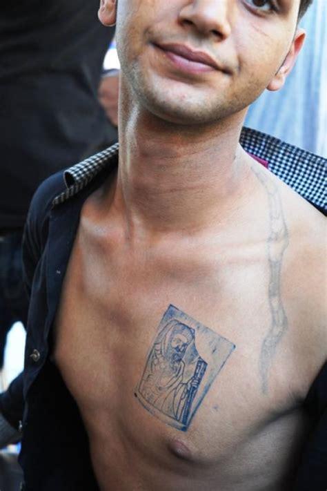 christian egyptian tattoo egypt persecuted coptic christians get their faith tattooed