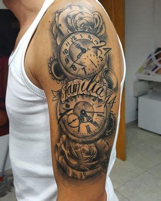 grey roses and clock tattoo on man left half sleeve by
