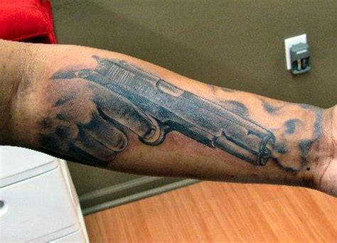 gun hand tattoo army gun design tattoos book