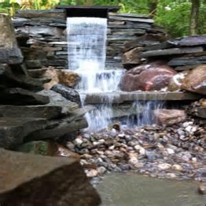 backyard pondless waterfalls pondless waterfall installation garden fountains and waterfalls pinterest