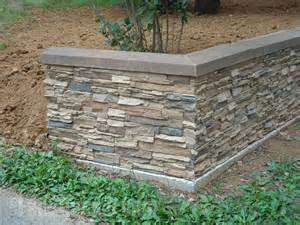 Wall with a facade that mimics the look of real stacked stone