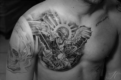 tattoo chest hold have arab pattern around shoulder arm chest and then have