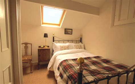 the little double room bedroom 9 has a small double bed woodlands house