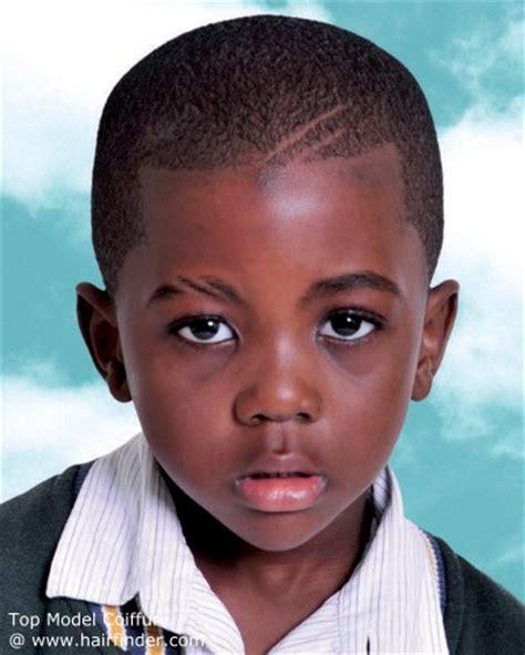 young black boy sporting a short buzzed haircut
