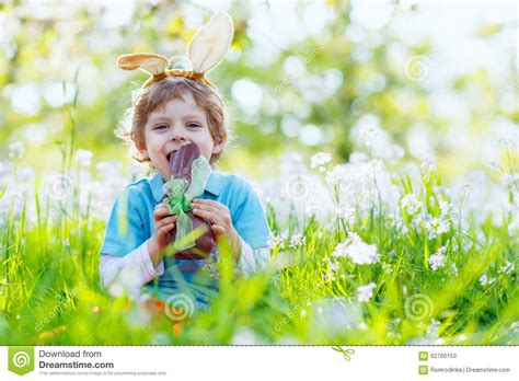 5 Adorable Families Celebrating Easter by Kid Boy Chocolate Easter Bunny Stock Image