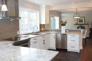 white speckle countertops with black appliances pics of snow white quartz countertop on painted white cabinets