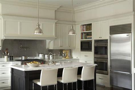white kitchen cabinets with metal backsplash ivory and black kitchen cabinets with stainless steel hex