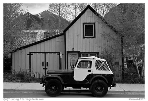 jeep house black and white picture photo jeep and blue house