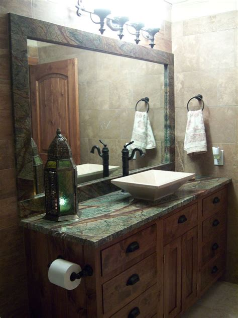 bathroom design with forest green granite countertops