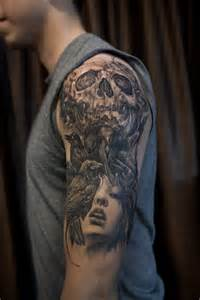 half sleeve black and grey crows skull and portrait