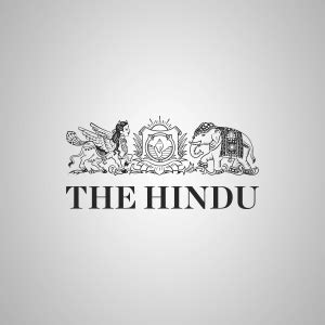 lorry trapped in crater on road the hindu