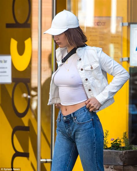 yolanda foster white tank top brand bella hadid braless in white crop top and jeans daily
