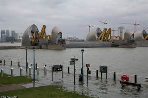 thames river today uk weather sees britain battered by extreme high tides