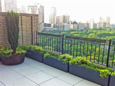central park roof garden terrace paver deck patio metal fence containers contemporary