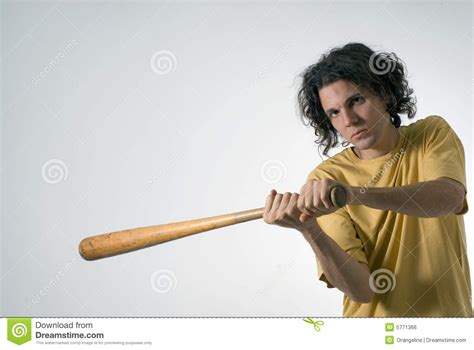 swinging man man swinging a baseball bat horizontal stock photo
