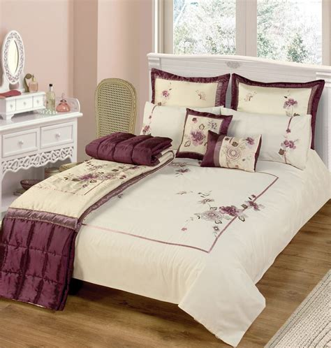 classic bedroom with purple beige duvet covers with flower motif light pink wall color paint
