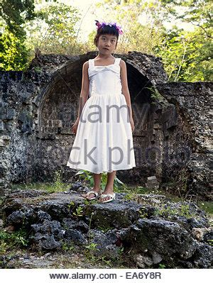young filipina girl 8 years old with sad and somber