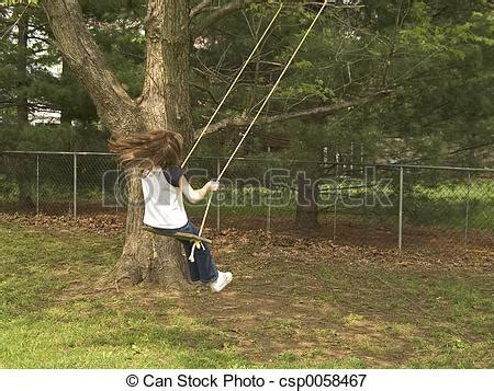 swinging in the backyard swinging in the backyard picture of backyard swing a child