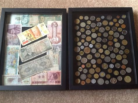 travel themed office decor shadow boxes with money we have collected in our travels