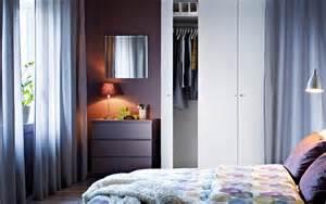 Purple bedroom with purple textiles a white pax wardrobe a white