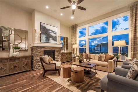 great room definition a stacked fireplace and expansive windows define this great room a new home in valley