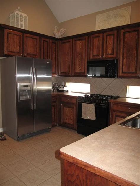 Wood Cabinets With Black Appliances by Wood Kitchen Cabinets With Stainless Steel Appliances