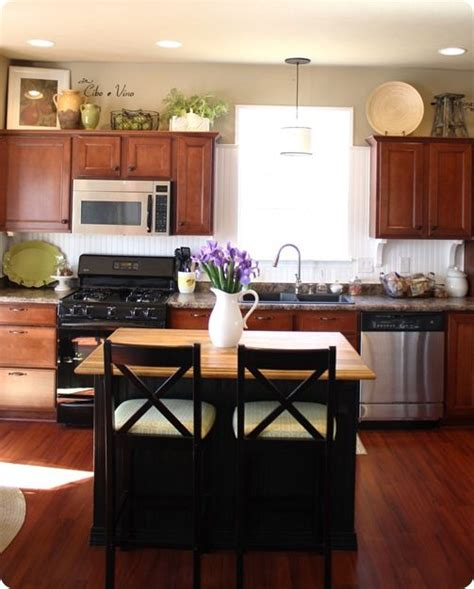 decorating top of kitchen cabinets best 25 over cabinet decorating ideas on pinterest