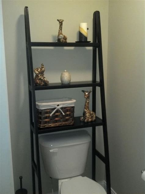 over the toilet bathroom shelves took a ladder shelf and left out the bottom 2 rows to fit