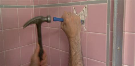 removing ceramic tile from bathroom walls how to remove a bathroom wall tile today s homeowner