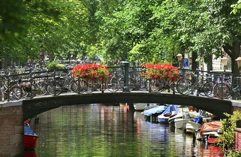 European Home Plans small bridge over canal in amsterdam netherlands stock