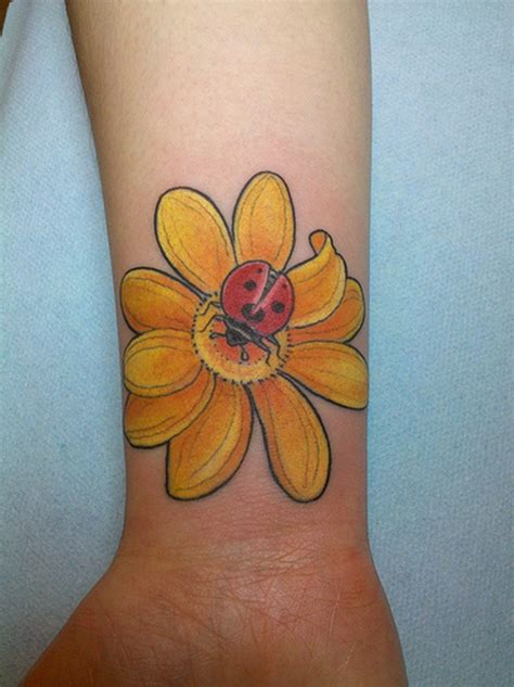 lady tattoo 34 awesome wrist flower tattoos