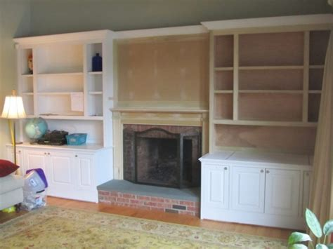 built in bookcase and mantle installation custom cabinet