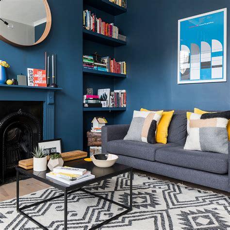 living room makeover featuring farrow ball stiffkey blue