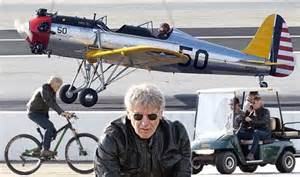 harrison ford ditches his bike and buggy for a flight in