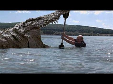 Tshirt Mancing Canal Fishing Putih Fights A Crocodile In Lake