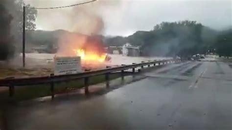 West Virginia Burning by West Virginia Floods Burning House Floating Away
