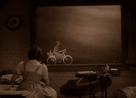 twister dorothy gif wizard of oz bike gif find share on giphy