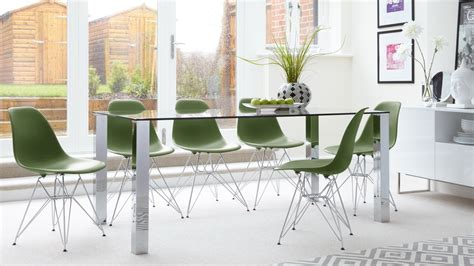 Contemporary Glass Dining Tables And Chairs Contemporary Glass 6 Seater Dining Table And Eames Dining Chairs With Metal Legs