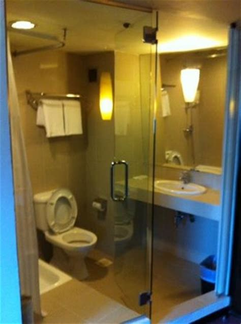 how to see through bathroom glass see through glass wall to bathroom picture of strand hotel singapore tripadvisor
