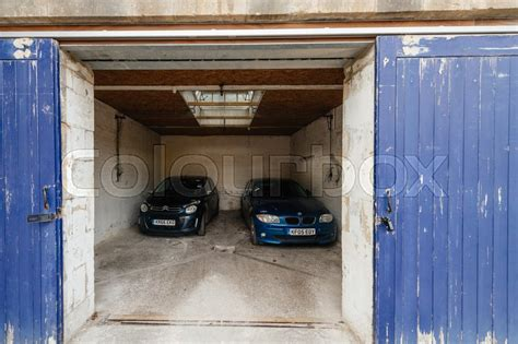 Unlock Garage Door From Inside Open Garage Door With Two Luxury Car Inside Security And Safety Of The Transportation Cars And