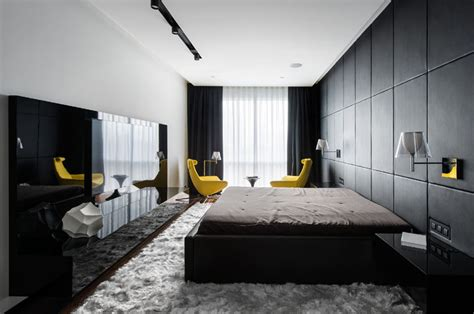 black and white bedroom with a pop of color this apartment has an almost entirely black and white