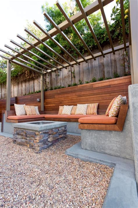 outdoor banquette seating built in concrete benches are topped by slatted wood
